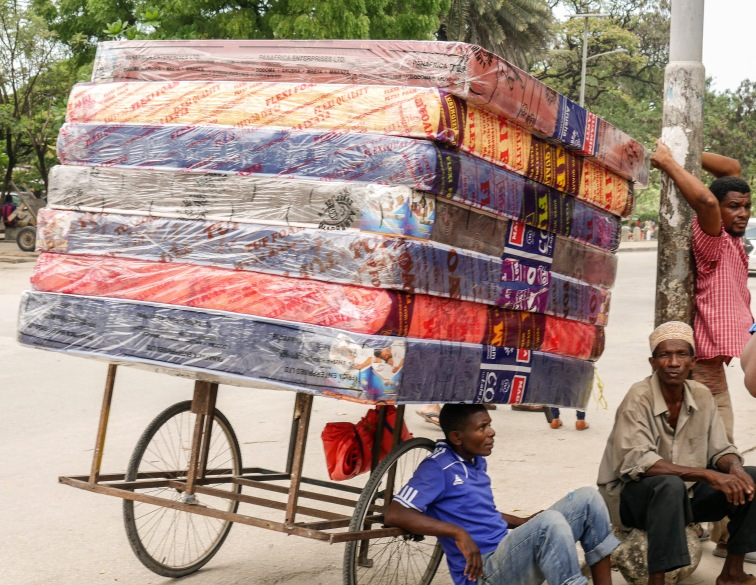 Selling mattresses on the street.